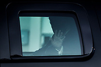 U.S. President Donald Trump waves from the Presidential motorcade while arriving to Walter Reed National Military Medical Center in Bethesda, Maryland, U.S., on Friday, Oct. 2, 2020. Trump will be treated for Covid-19 after being in isolation at the White House since his diagnosis, which he announced after one of his closest aides had tested positive for coronavirus infection.<br /> Credit: Oliver Contreras / Pool via CNP/AdMedia
