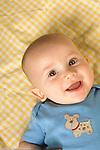 6 month old baby boy portrait closeup, happy