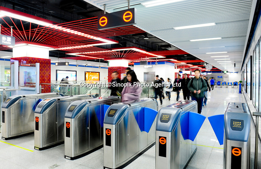 Passengers passby the electronic turnstiles in Chengdu underground Line 1, Chengdu, China.Construction of the 18·5 km line began on December 28 2005 and cost around 8bn yuan. The route runs from Shenxian Lake in the north of Chengdu to Century City, via South Railway Station, and has 16 stations.Chengdu is planning to build a 298 km network with seven lines by 2020, with a total a capacity of 300 million passengers a year..12 Mar 2011