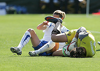 Kelly Smith (left) collides with FC Gold Pride keeper Nicole Barnhart (right). FC Gold Pride defeated the Boston Breakers 2-1 at Buck Shaw Stadium in Santa Clara, California on April 5th, 2009. Photo by Kelley Cox /isiphotos.com
