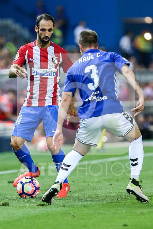 Atletico de Madrid's Juanfran Torres and Deportivo Alaves's Raul Garcia during the match of La Liga Santander between Atletico de Madrid and Deportivo Alaves at Vicente Calderon Stadium. August 21, 2016. (ALTERPHOTOS/Rodrigo Jimenez)