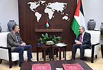 "Palestinian Prime Minister Mohammad Ishtayeh meets with a delegation from the ""Tkiyet Um Ali"" organization in the Hashemite Kingdom of Jordan, in the West Bank city of Ramallah on April 21, 2021. Photo by Prime Minister Office"