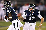 Nevada's Cody Fajardo (17) hands the ball off to Don Jackson (6) during the first half of an NCAA college football game against Fresno State in Reno, Nev., on Saturday, Nov. 22, 2014. (AP Photo/Cathleen Allison)
