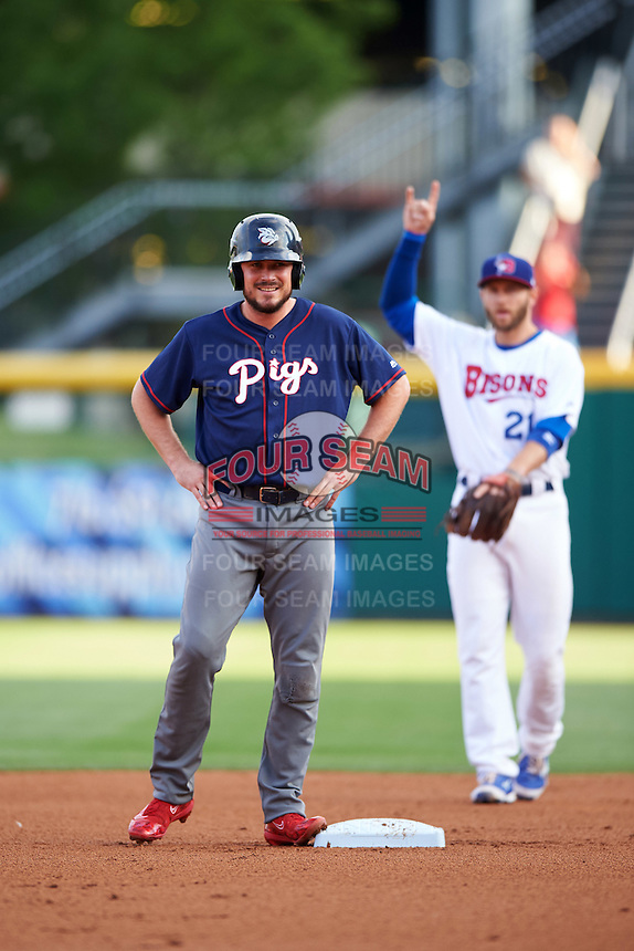 Lehigh Valley IronPigs first baseman Brock Stassi (10) on second as David Adams (21) signals two outs in the background during a game against the Buffalo Bisons on July 9, 2016 at Coca-Cola Field in Buffalo, New York.  Lehigh Valley defeated Buffalo 9-1 in a rain shortened game.  (Mike Janes/Four Seam Images)