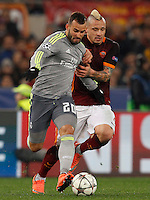 Calcio, andata degli ottavi di finale di Champions League: Roma vs Real Madrid. Roma, stadio Olimpico, 17 febbraio 2016.<br /> Real Madrid's Jese', left, is challenged by Roma's Radja Nainggolan during the first leg round of 16 Champions League football match between Roma and Real Madrid, at Rome's Olympic stadium, 17 February 2016.<br /> UPDATE IMAGES PRESS/Riccardo De Luca