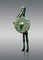Iron Age Nuragic broze statue of a soldier with a shield and sword from Monte Arcosu di Uta, Sardinia. Museo archeologico nazionale, Cagliari, Italy. (National Archaeological Museum)  - Grey Background