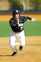 Joey Rodriguez (7) of the Wake Forest Demon Deacons takes off for third base against the Youngstown State Penguins at Wake Forest Baseball Park on February 24, 2013 in Winston-Salem, North Carolina.  (Brian Westerholt/Four Seam Images)