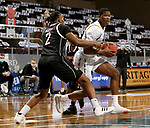 SIOUX FALLS, SD - MARCH 6: Douglas Wilson #35 of the South Dakota State Jackrabbits looks to make a move against Darrius Hughes #2 of the Nebraska-Omaha Mavericks during the Summit League Basketball Tournament at the Sanford Pentagon in Sioux Falls, SD. (Photo by Dave Eggen/Inertia)