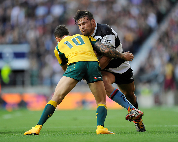 Angus Ta'avao of Barbarians runs into the tackle of Quade Cooper of Australia during the Killik Cup match between Barbarians and Australia at Twickenham Stadium on Saturday 1st November 2014 (Photo by Rob Munro)