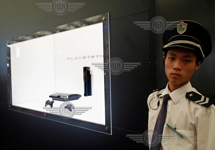 A guard stands next to a Sony PlayStation 3 (PS3) display at the 2006 China Joy Digital Entertainment Expo. China has one of the fastest growing online gaming markets in the world.