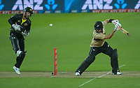 NZ's Glenn Phillips swings and misses as the ball bounces off Matthew wade during the 4th international men's T20 cricket match between the New Zealand Black Caps and Australia at Sky Stadium in Wellington, New Zealand on Friday, 5 March 2021. Photo: Dave Lintott / lintottphoto.co.nz