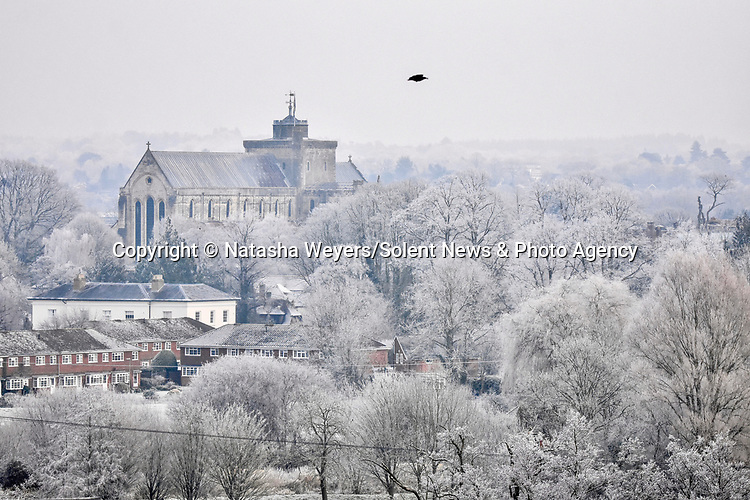 Pictured: Blanket of frost this morning over the top of Romsey Abbey and the surrounding trees.<br /> <br /> Romsey, Hants became a winter wonderland this morning with temperatures dropping to below zero.<br /> <br /> Please byline: Natasha Weyers/Solent News<br /> <br /> © Natasha Weyers/Solent News & Photo Agency<br /> UK +44 (0) 2380 458800