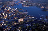 Aerial view of Norfolk (foreground) and Portsmouth Virginia (across water) on the Elizabeth River. The naval shipyards are visible across the river in Portsmouth. Norfolk, Portsmouth Virginia USA Tidewater.