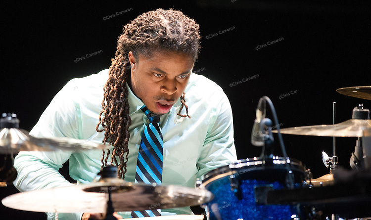 Maceo's nephew, Marcus Parker, plays with Maceo Parker and the Nighthawks at the Vogue June 25, 2014.