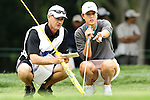 USA Michelle Wie (right) and her caddie (left) review the 6th green at the LPGA Championship 2011 Sponsored By Wegmans at Locust Hill Country Club in Rochester, New York on June 25, 2011