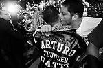 ARTURO GATTI (11/12) --A fan reaches out and kisses Arturo as he is led from the ring to his dressing room after being beaten by TKO at the hands of top-ranked contender Floyd Mayweather, Jr. before a sellout pro-Gatti crowd at Atlantic City's Boardwalk Hall.  ATLANTIC CITY, NJ  6/25/05