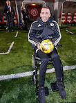 Fernando Ricksen watches Rangers warming up as he sits in his wheelchair at the trackside