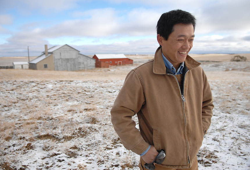 Sheldon Zou walks in the yard of his farm near Ogema, Sask. Zou immigrated from China to Ogema in 2008 with his his wife and two daughters. This was my first photo published above the fold on the front page of The Globe and Mail.