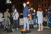 Television reporters await results in the 2020 presidential election as demonstrators gather in Black Lives Matter Plaza near the White House on the night of Election Day in Washington, D.C., on Tue., Nov. 3, 2020. Election results remained uncertain late into the night and demonstrators were peaceful.