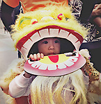 A young child peeks through his dragon head to view the Chinese New Years Parade in San Francisco.
