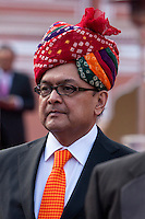 Jaipur, Rajasthan, India.  Gentleman in Western Suit and Tie with Traditional Rajasthani Turban.