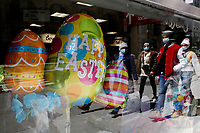 NEW YORK - NEW YORK - APRIL 03: People are reflected on a window displaying Easter decorations on April 03, 2021 in New York. NYC and most of the United States are planning a year later after pandemic, the celebration of the of Easter which may return with some of normalcy under New York state guidelines. (Photo by John Smith/VIEWpress)