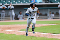 Montgomery Biscuits catcher Rene Pinto (11) hustles down the first-base line against the Tennessee Smokies on May 9, 2021, at Smokies Stadium in Kodak, Tennessee. (Danny Parker/Four Seam Images)