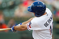 Round Rock Express designated hitter Lance Berkman (12) connects on a home run during the third inning of the Pacific Coast League baseball game against the Salt Lake Bees on August 10, 2013 at the Dell Diamond in Round Rock, Texas. Round Rock defeated Salt Lake 9-6. (Andrew Woolley/Four Seam Images)