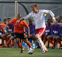 Nigel de Jong (L) of Holland and Nicklas Bendtner (R) of Denmark