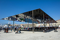 Marseille (13) on 02/03/2013: inauguration of the renovated part of the Old Port. procession, parade; crowd. Here, the shade structure of the Old Port, designed and created by British architect Norman Foster