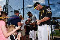 Pittsburgh Pirates catcher Jacob Stallings (58) and Starling Marte (left) sign autographs after the teams first Spring Training practice on February 18, 2019 at Pirate City in Bradenton, Florida.  (Mike Janes/Four Seam Images)