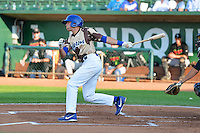 Michael Ahmed (14) of the Ogden Raptors at bat against the Great Falls Voyagers in Pioneer League action at Lindquist Field on July 17, 2014 in Ogden, Utah.  (Stephen Smith/Four Seam Images)