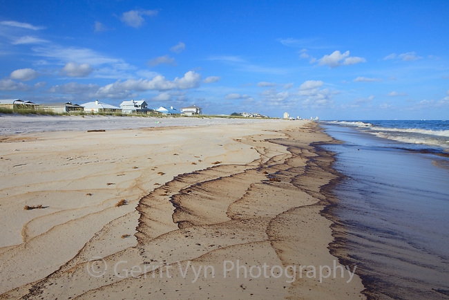 Cottages line an oiled beach from the BP Deepwater Horizon oil leak. Baldwin County, Alabama. June 2010.