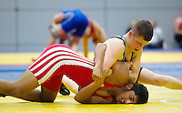 11 MAY 2014 - SHEFFIELD, GBR - Ryan Kay (top) attempts to overpower Bobby Singh during their freestyle match at the British 2014 Senior Wrestling Championships in EIS in Sheffield, Great Britain (PHOTO COPYRIGHT © 2014 NIGEL FARROW, ALL RIGHTS RESERVED)