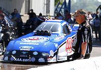 Sep 29, 2013; Madison, IL, USA; Jason Sharp , crew member for NHRA funny car driver Robert Hight during the Midwest Nationals at Gateway Motorsports Park. Mandatory Credit: Mark J. Rebilas-
