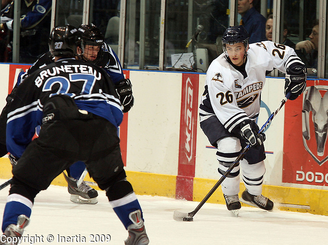 SIOUX FALLS, SD - APRIL 14:  Marc Rodriguez #26 of the Sioux Falls Stampede looks past the defense of Matt Bruneteau #27 of the Lincoln Stars in the first period of their third game in the opening round series in the USHL Playoffs Tuesday night at the Sioux Falls Arena. (Photo by Dave Eggen/Inertia)