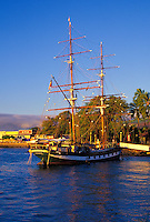 The replica brig the Carthaginian III in Lahaina Harbor catches the last light of day to the right of Front Street in historic Lahaina town. From 1820-circa.1860, Lahaina was the whaling capital of the world.