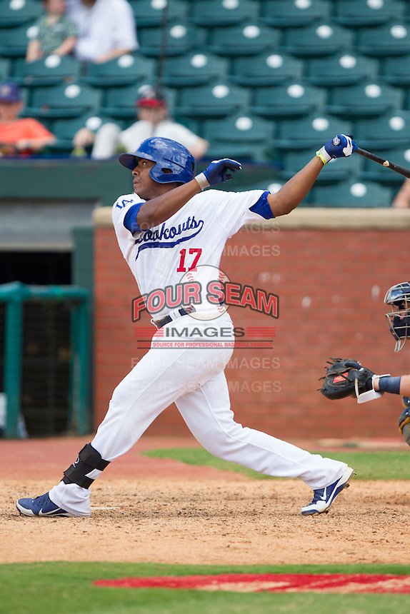 Daniel Mayora (17) of the Chattanooga Lookouts follows through on his swing against the Montgomery Biscuits at AT&T Field on July 23, 2014 in Chattanooga, Tennessee.  The Lookouts defeated the Biscuits 6-5. (Brian Westerholt/Four Seam Images)