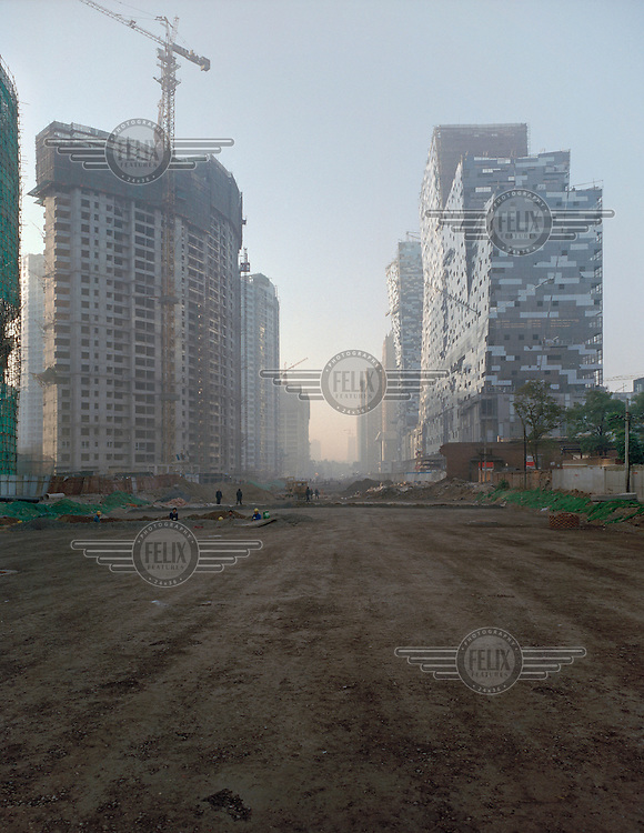 Construction site of a new real estate development named 'SOHO'.  The Western name aims to target the middle and upper classes as potential residents.
