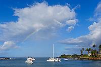 A rainbow over Kukui'ula Harbor, Kaua'i.