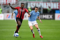 Franck Kessie of AC Milan and Adam Marusic of SS Lazio compete for the ball during the Serie A 2021/2022 football match between AC Milan and SS Lazio at Giuseppe Meazza stadium in Milano (Italy), August 29th, 2021. Photo Image Sport / Insidefoto