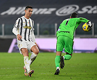 Football Soccer: Tim Cup Semi Finals second leg Juventus vs InternazionaleMilan, Allianz Staium Stadium in Turin, on February 9, 2021.<br /> Juventus' Cristiano Ronaldo (l) in action with Inter's goalkeeper and captain Samir Handanovic (r) during the Italian Tim Cup Semi Final match between Juventus vs InterMilan at Allianz Stadium in Turin, on February 9, 2021.<br /> UPDATE IMAGES PRESS/Isabella Bonotto