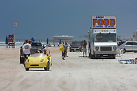 People,cars and consession stands occupy Daytona Beach,Florida. Atlantic Ocean (do)