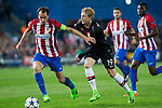 Diego Godin of Atletico de Madrid competes for the ball with Julian Brandt of Bayer 04 Leverkusen during the match of Uefa Champions League between Atletico de Madrid and Bayer Leverkusen at Vicente Calderon Stadium  in Madrid, Spain. March 15, 2017. (ALTERPHOTOS / Rodrigo Jimenez)