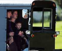 An Amish family in a horse and buggy drives by the media October 3, 2006 near the shooting scene at the one room school house where a gunman killed three schoolgirls execution style and then shot himself yesterdayin Nickel Mines, Pa.It was the third U.S. school shooting in less than a week, this time in a peaceful largely Amish community, where descendants of German settlers have preserved a religious lifestyle that shuns modernities like cars and electricity. REUTERS/Bradley C Bower
