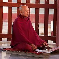 Myanmar, Burma, Shwezegon (Shwezigon) Pagoda, near Bagan.  Monk Meditating, Praying.