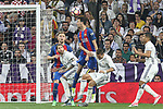 Sergio Busquets and Ivan Rakitic competes for the ball with Sergio Ramos and Cristiano Ronaldo of Real Madrid during the match of La Liga between Real Madrid and Futbol Club Barcelona at Santiago Bernabeu Stadium  in Madrid, Spain. April 23, 2017. (ALTERPHOTOS)