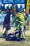 © Joel Goodman - 07973 332324 . 07/04/2017 . Manchester , UK . 7th in a sequence . Five youths on one as a fight breaks out in which a man's head is kicked and stamped upon , in Piccadilly Gardens . Greater Manchester Police have authorised dispersal powers and say they will ban people from the city centre for 48 hours , this evening (7th April 2017) , in order to tackle alcohol and spice abuse . Photo credit : Joel Goodman