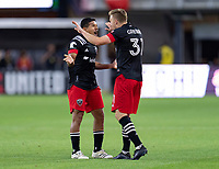 WASHINGTON, DC - MAY 13: Edison Flores #10 of D.C. United celebrates his goal with Julian Gressel #31 during a game between Chicago Fire FC and D.C. United at Audi FIeld on May 13, 2021 in Washington, DC.