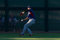 AZL Rangers left fielder Kobie Taylor (3) throws to second base during an Arizona League game against the AZL Giants Black at Scottsdale Stadium on August 4, 2018 in Scottsdale, Arizona. The AZL Giants Black defeated the AZL Rangers by a score of 3-2 in the first game of a doubleheader. (Zachary Lucy/Four Seam Images)